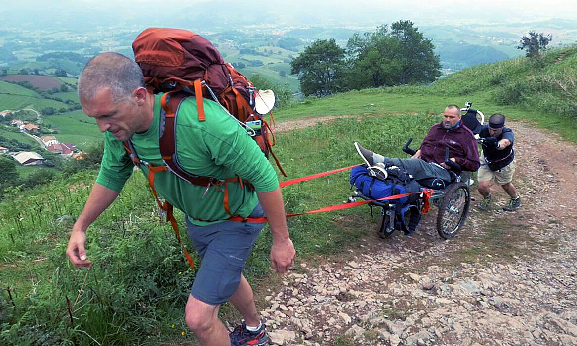 Justin being pulled uphill in his custom wheelchair